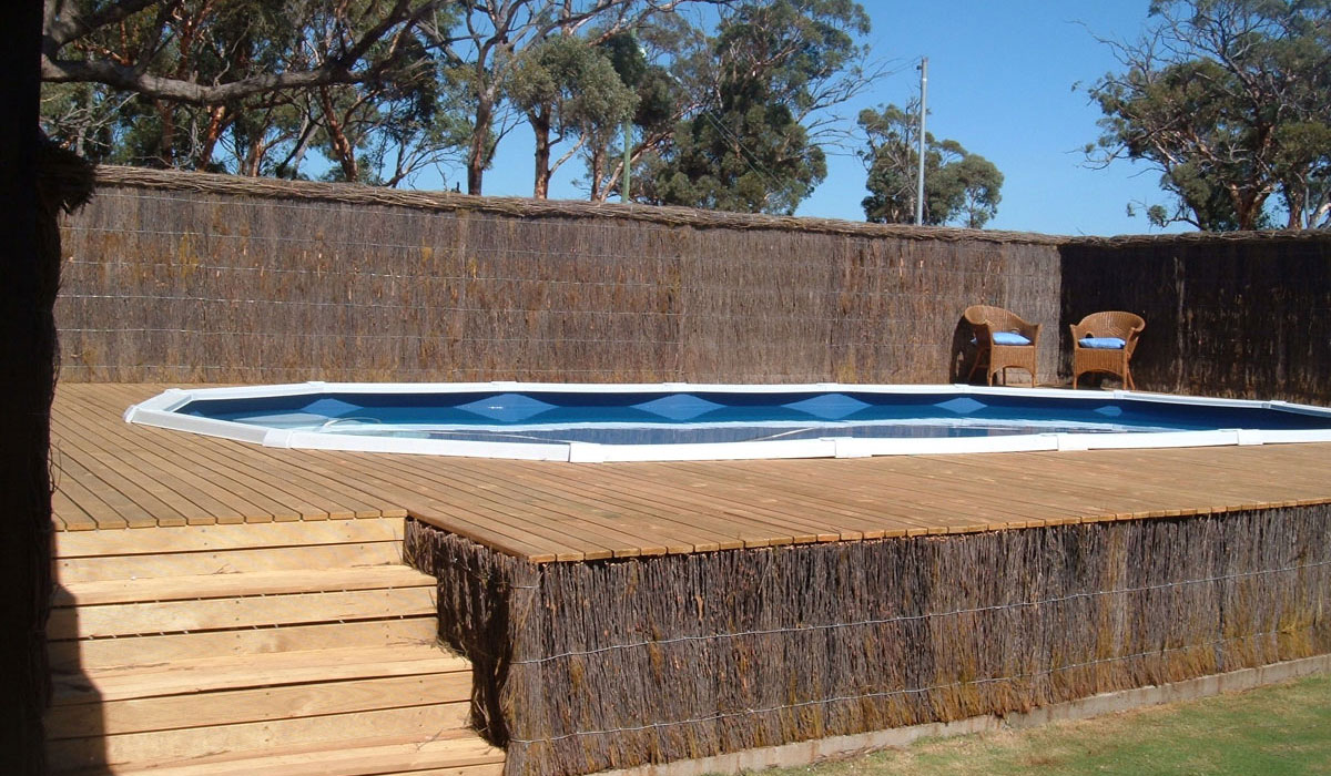 Above ground pools melbourne pools r us for How to build a wood deck around a round pool